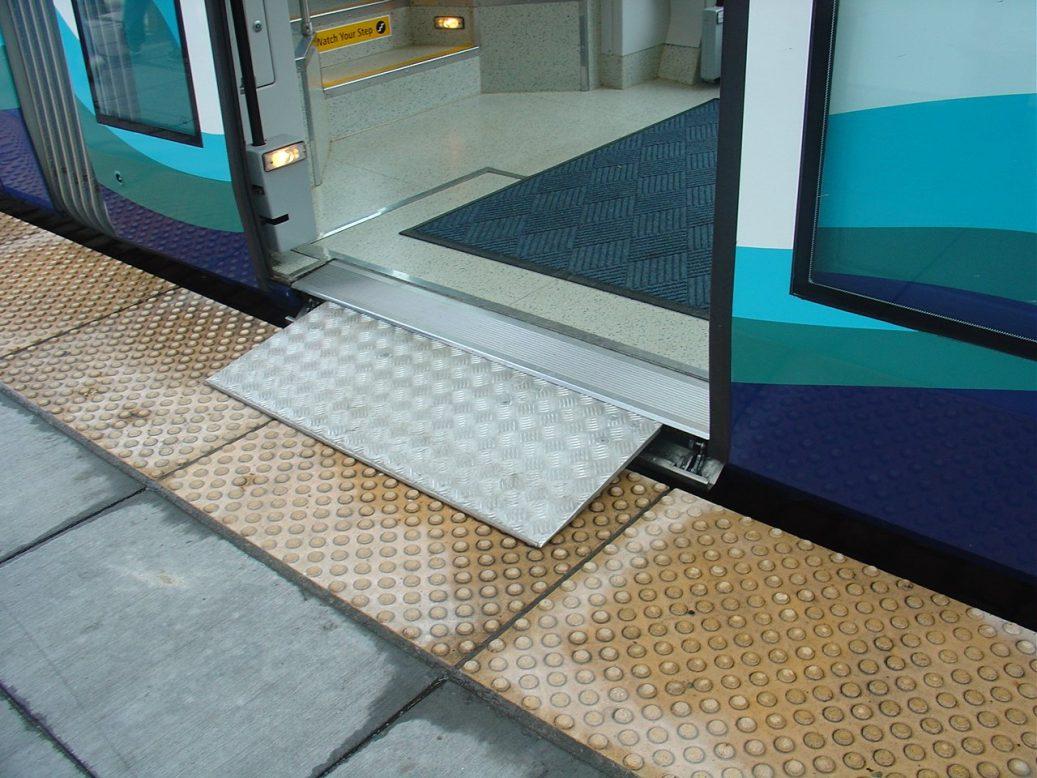 Wheelchair ramp with textured sidewalk