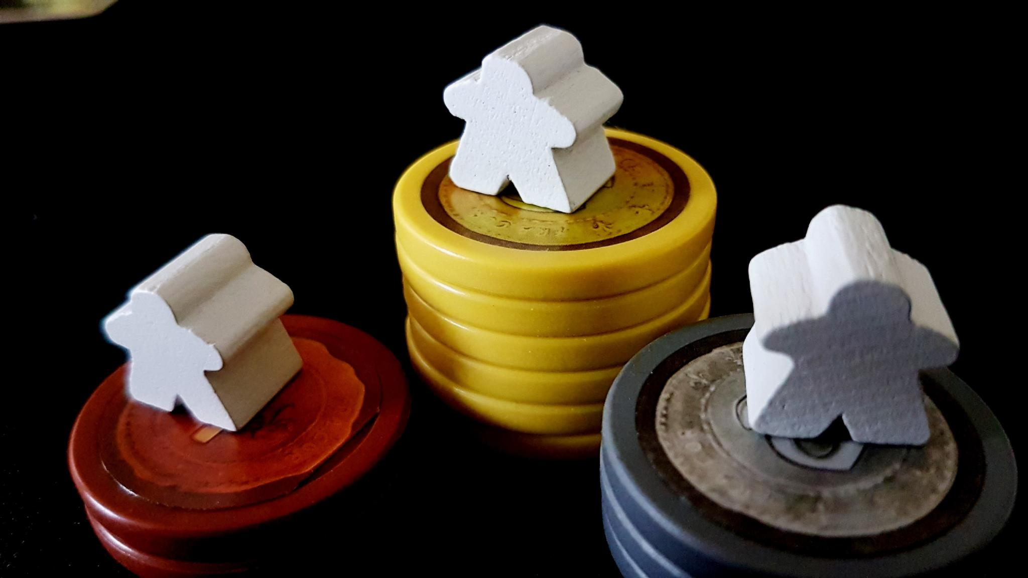Meeples on Piles of Tokens